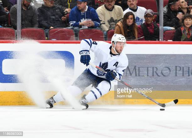 Morgan Rielly of the Toronto Maple Leafs skates with the puck against the Arizona Coyotes at Gila River Arena on November 21, 2019 in Glendale,...