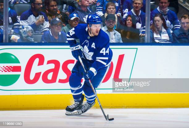Morgan Rielly of the Toronto Maple Leafs skates with the puck against the New York Rangers during the first period at the Scotiabank Arena on...