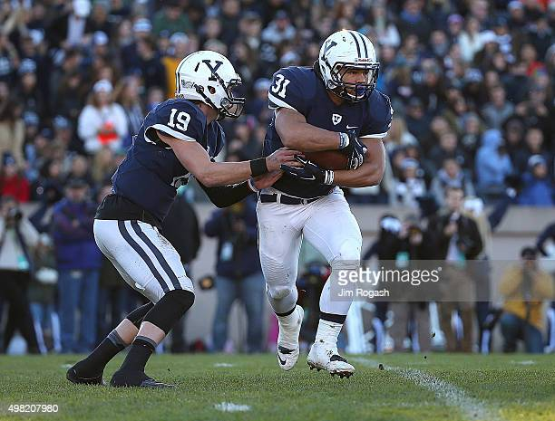 Morgan Roberts of the Yale Bulldogs hands the ball to Jordan Becerra in the second quarter against the Harvard Crimson in the first half on November...