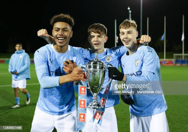 Morgan Rogers, James McAtee and Cole Palmer of Manchester City celebrate with the trophy during the FA Youth Cup Final match between Manchester City...