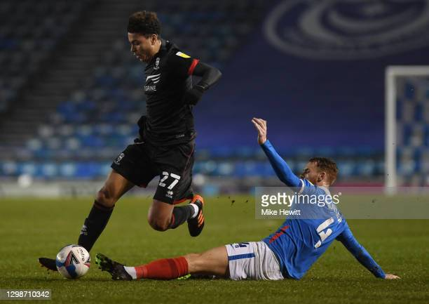 Morgan Rogers of Lincoln City is challenged by Tom Naylor of Portsmouth FC during the Sky Bet League One match between Portsmouth and Lincoln City at...