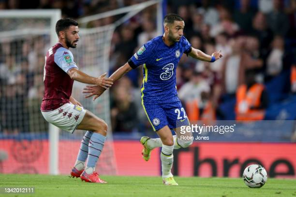 Morgan Sanson of Aston Villa closes down Hakim Ziyech of Chelsea during the Carabao Cup Third Round match between Chelsea and Aston Villa at Stamford...