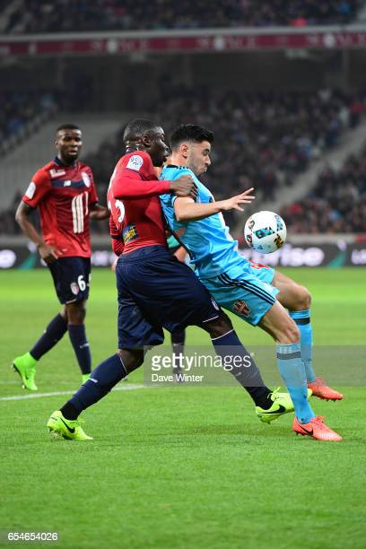 Morgan Sanson of Marseille and Adama Soumaoro of Lille during the Ligue 1 match between Lille OSC and Olympique de Marseille at Stade Pierre Mauroy...