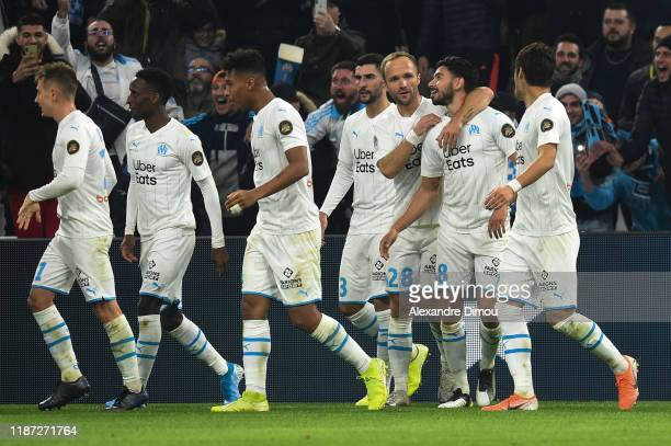 Morgan Sanson of Marseille celebrates his scoring with team-mates during the Ligue 1 match between Olympique Marseille and Girondins Bordeaux at...