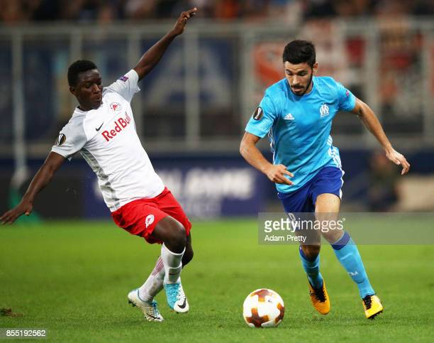 Morgan Sanson of Marseille is challenged by Amadou Haidara of Red Bull Salzburg during the UEFA Europa League group I match between RB Salzburg and...