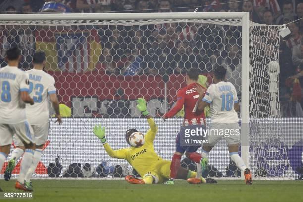 Morgan Sanson of Olympique Marseille Adil Rami of Olympique Marseille goalkeeper Steve Mandanda of Olympique Marseille Antoine Griezmann of Club...