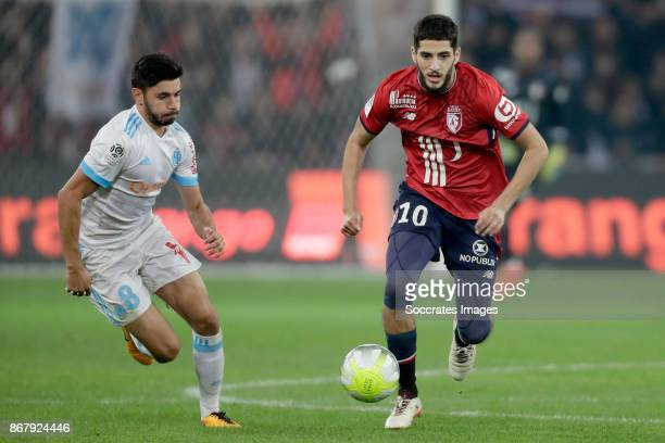 Morgan Sanson of Olympique Marseille Yassine Benzia of Lille during the French League 1 match between Lille v Olympique Marseille at the Stade Pierre...