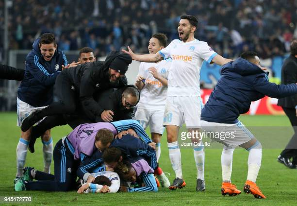 Morgan Sanson of OM and teammates celebrate the fifth goal for Marseille during the UEFA Europa League quarter final leg two match between Olympique...