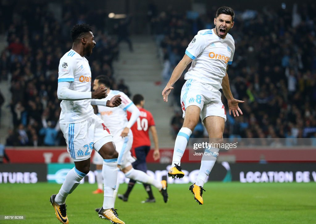 Morgan Sanson of OM celebrates his goal with Andre Zambo Anguissa (left) during the French Ligue 1 match between Lille OSC (LOSC) and Olympique de Marseille (OM) at Stade Pierre Mauroy on October 29, 2017 in Lille, France.