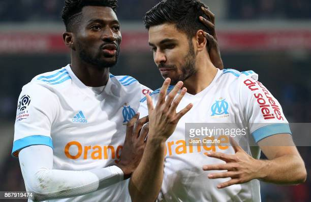 Morgan Sanson of OM celebrates his goal with Andre Zambo Anguissa during the French Ligue 1 match between Lille OSC and Olympique de Marseille at...