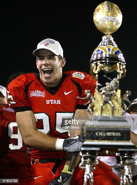 Morgan Scalley celebrates with the trophy after his team defeated Pittsburgh 357 in the Tostito's Fiesta Bowl at the Sun Devil Stadium on January 1...