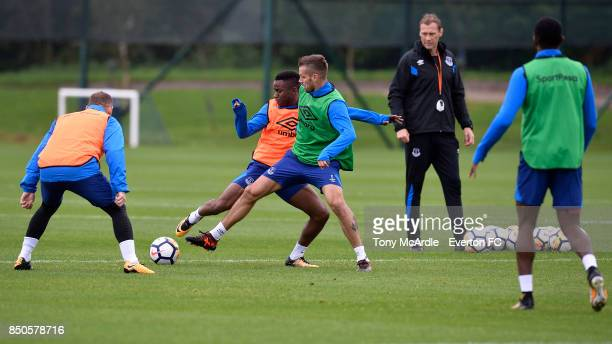 Morgan Schneiderlin and Ademola Lookman chaedge for the ball during the Everton training session at USM Finch Farm on September 21 2017 in Halewood...
