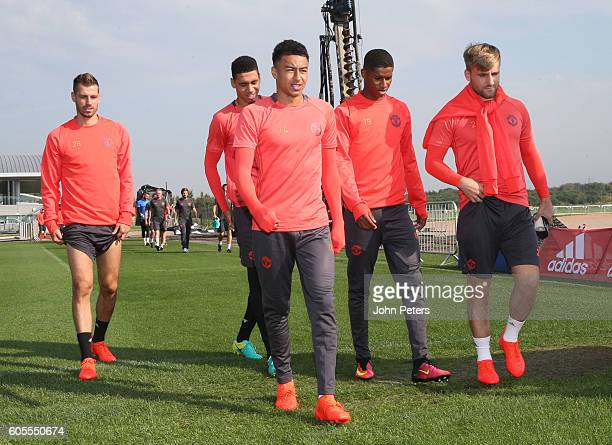 Morgan Schneiderlin Chris Smalling Jesse Lingard Marcus Rashford and Luke Shaw of Manchester United walk together during a Manchester United training...