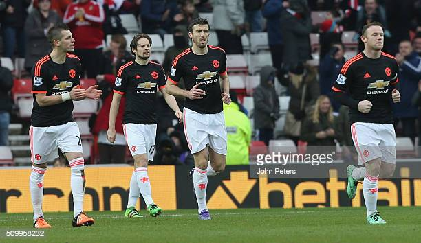 Morgan Schneiderlin Daley Blind Michael Carrick and Wayne Rooney of Manchester United react to Wahbi Khazri of Sunderland scoring their first goal...