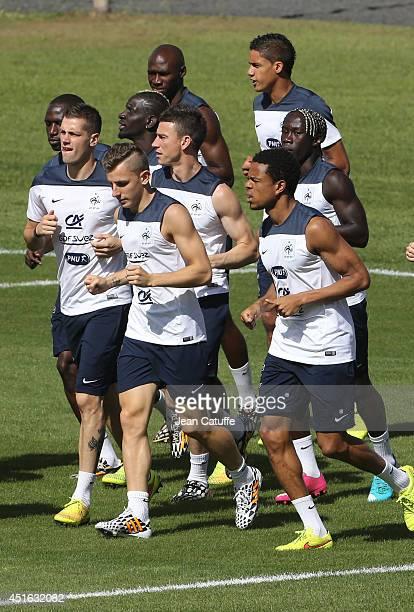 Morgan Schneiderlin Lucas Digne Laurent Koscielny Loic Remy warm up during the training session held at the Estadio Santa Cruz during the 2014 FIFA...