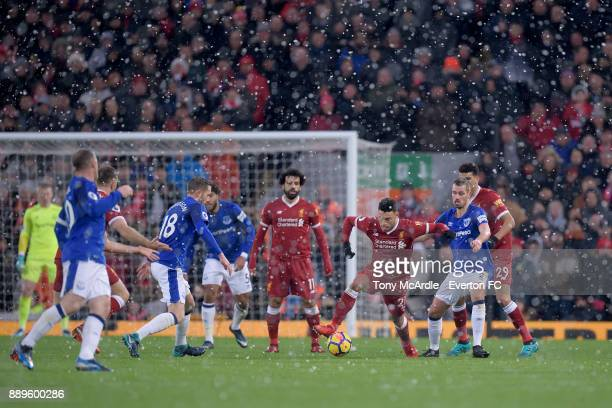 Morgan Schneiderlin of Everton and Alex OxladeChamberlain during the Premier League match between Liverpool and Everton at Anfield on December 10...