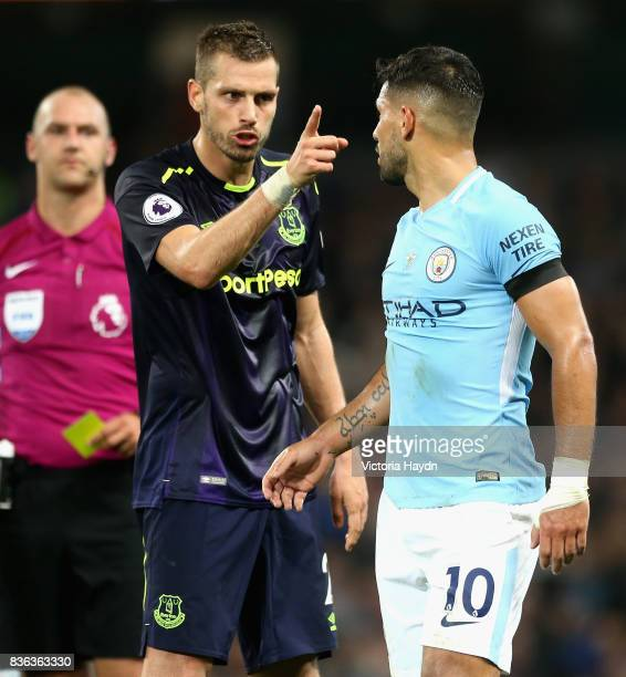 Morgan Schneiderlin of Everton and Sergio Aguero of Manchester City square up after Morgan Schneiderlin of Everton is shown a red card during the...