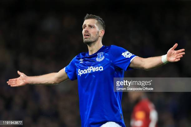 Morgan Schneiderlin of Everton asks questions during the FA Cup Third Round match between Liverpool and Everton at Anfield on January 5 2020 in...