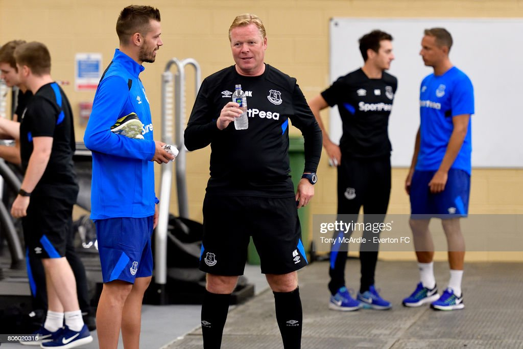 Morgan Schneiderlin of Everton chats to Ronald Koeman as he eturns to training at USM Finch Farm on July 3, 2017 in Halewood, England.