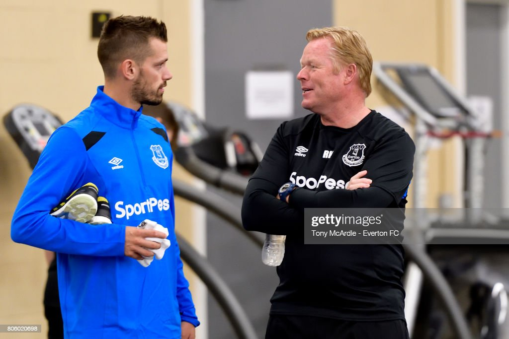 Morgan Schneiderlin of Everton chats to Ronald Koeman as he returns to training at USM Finch Farm on July 3, 2017 in Halewood, England.