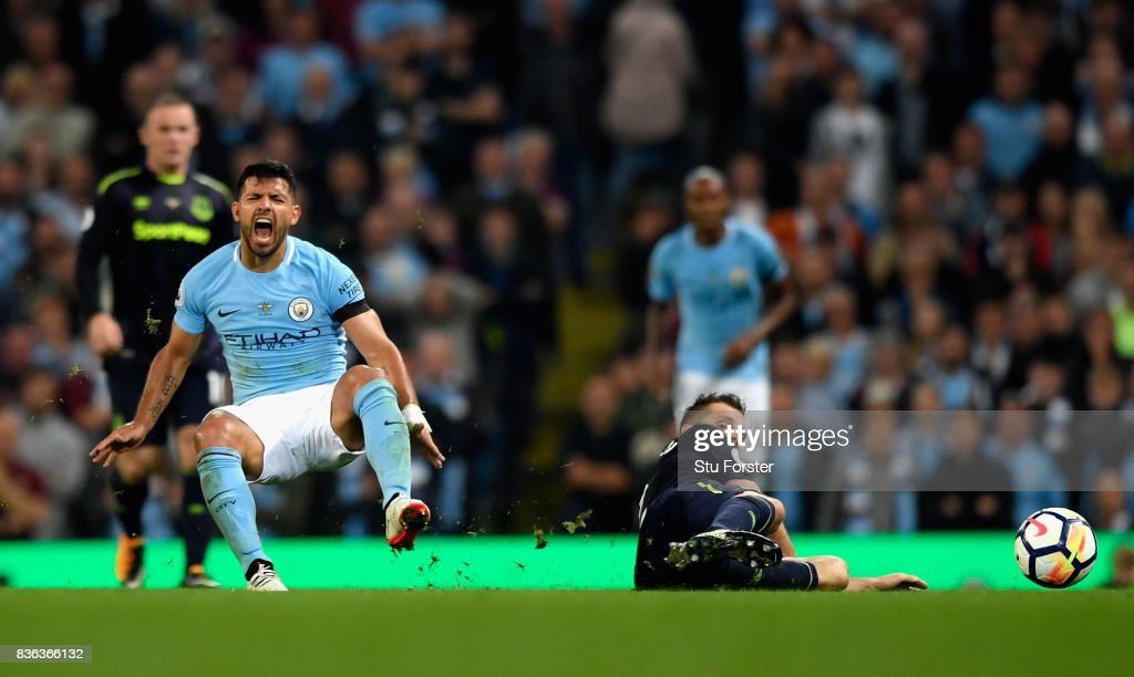 Morgan Schneiderlin of Everton fouls Sergio Aguero of Manchester City prior to being shown a second yellow card during the Premier League match between Manchester City and Everton at Etihad Stadium on August 21, 2017 in Manchester, England.