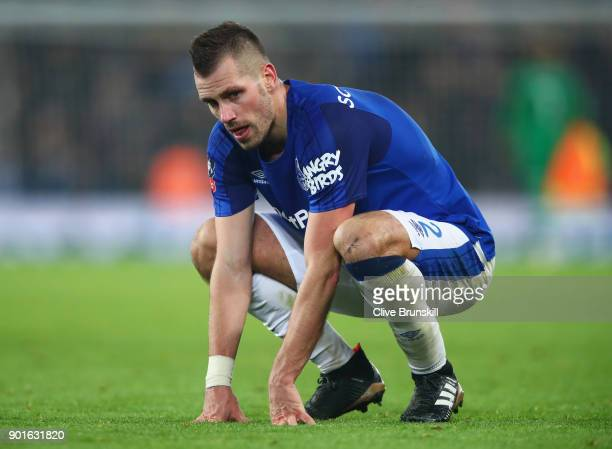 Morgan Schneiderlin of Everton looks dejected in defeat after the Emirates FA Cup Third Round match between Liverpool and Everton at Anfield on...