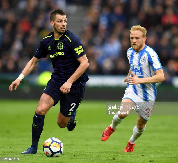 Morgan Schneiderlin of Everton runs with the ball under pressure from Alex Pritchard of Huddersfield Town during the Premier League match between...
