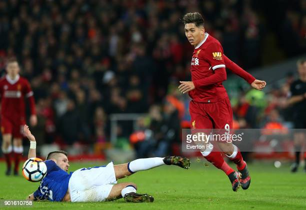 Morgan Schneiderlin of Everton slides in for a tackle on Roberto Firmino of Liverpool during the Emirates FA Cup third round match between Liverpool...