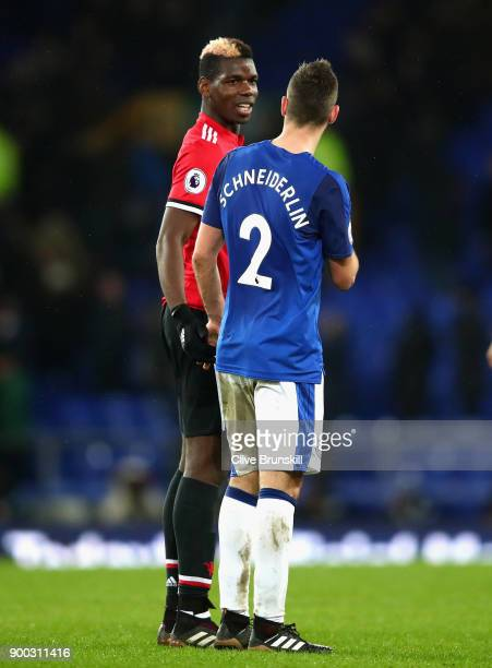 Morgan Schneiderlin of Everton speaks with Paul Pogba of Manchester United after the match during the Premier League match between Everton and...