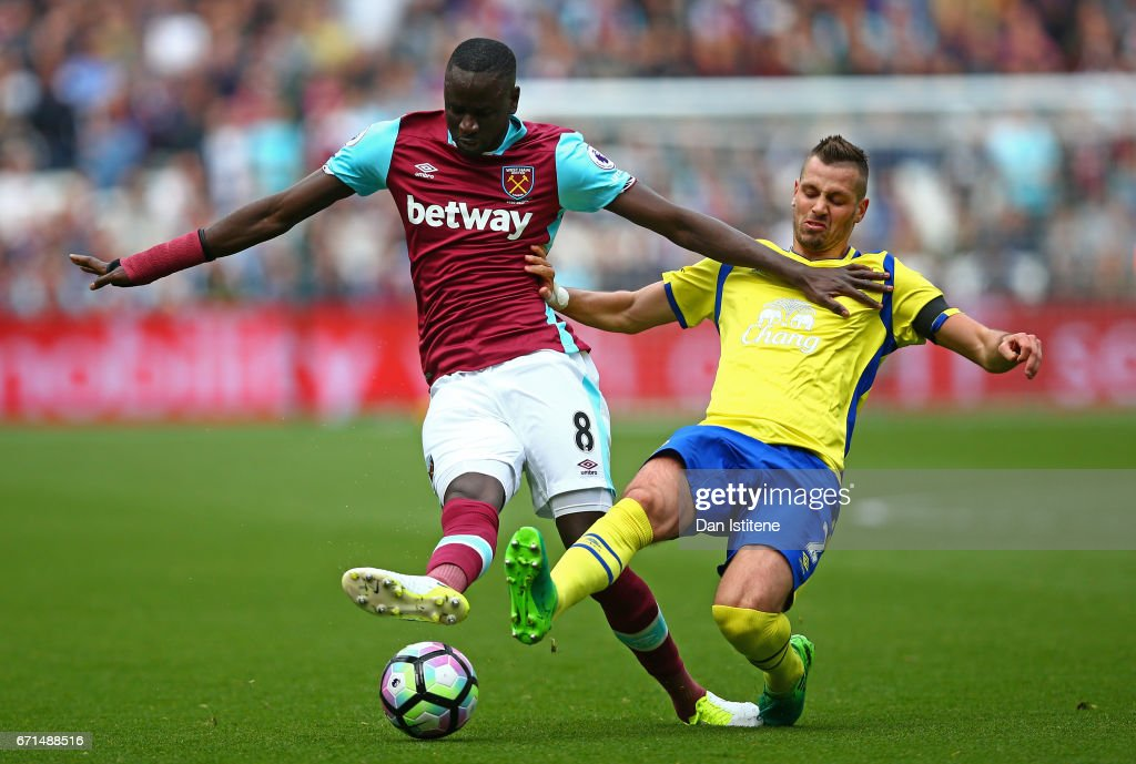 Morgan Schneiderlin of Everton tackles Cheikhou Kouyate of West Ham United during the Premier League match between West Ham United and Everton at the London Stadium on April 22, 2017 in Stratford, England.