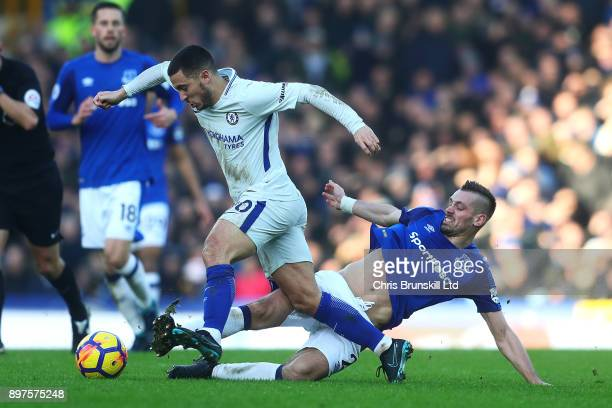Morgan Schneiderlin of Everton tackles Eden Hazard of Chelsea during the Premier League match between Everton and Chelsea at Goodison Park on...