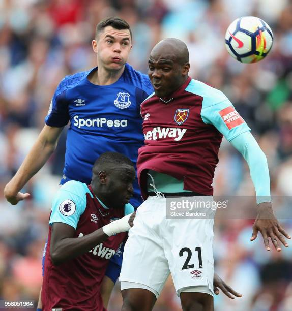 Morgan Schneiderlin of Everton wins a header from Angelo Ogbonna of West Ham United during the Premier League match between West Ham United and...