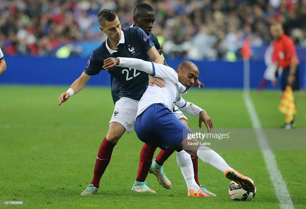 Morgan Schneiderlin of France and Joao Mario of Portugal during the International Friendly Soccer match between France and Portugal at Stade de France on october 11, 2014 in Paris, France.