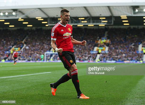 Morgan Schneiderlin of Manchester United celebrates scoring his team's first goal during the Barclays Premier League match between Everton and...