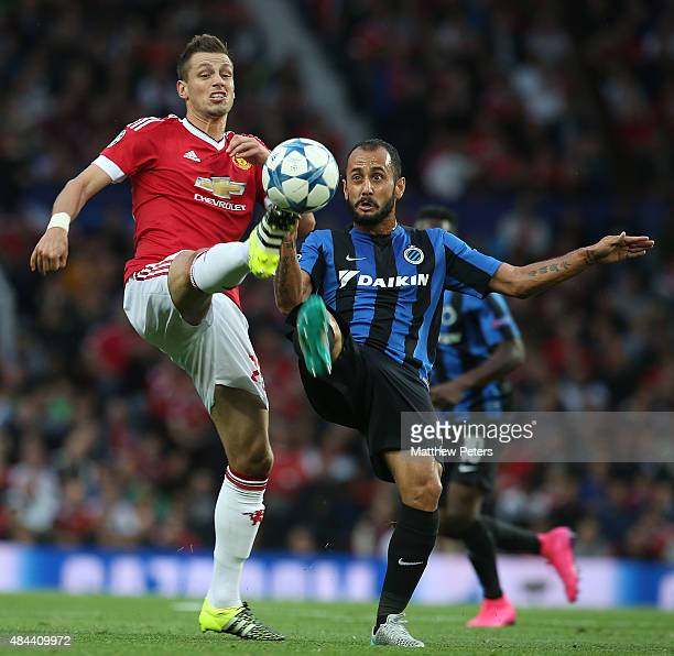 Morgan Schneiderlin of Manchester United in action with Victor Vazquez of Club Brugge during the UEFA Champions League playoff first leg match...
