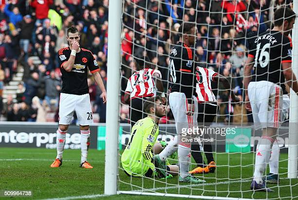 Morgan Schneiderlin of Manchester United reacts after Sunderland's second goal during the Barclays Premier League match between Sunderland and...