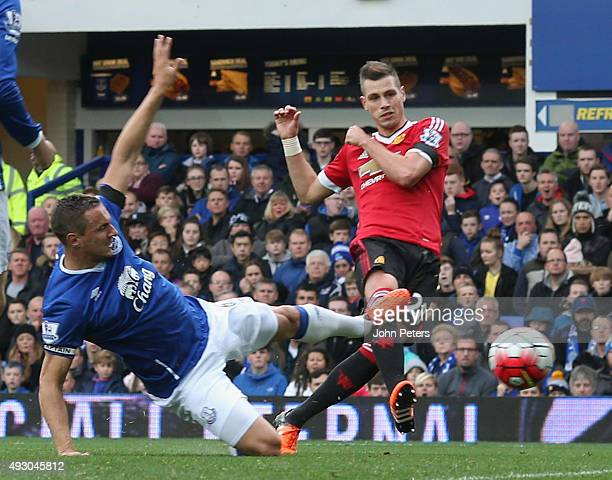 Morgan Schneiderlin of Manchester United scores their first goal during the Barclays Premier League match between Everton and Manchester United at...