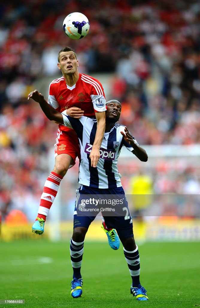 Morgan Schneiderlin of Southampton battles with Youssouf Mulumbu of West Bromwich Albion during the Barclays Premier League match between West Bromwich Albion and Southampton at The Hawthorns on August 17, 2013 in West Bromwich, England.