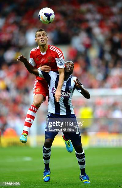 Morgan Schneiderlin of Southampton battles with Youssouf Mulumbu of West Bromwich Albion during the Barclays Premier League match between West...