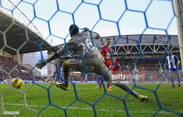 Morgan Schneiderlin of Southampton beats Ali Al Habsi of Wigan Athletic to score their second goal during the Barclays Premier League match between...