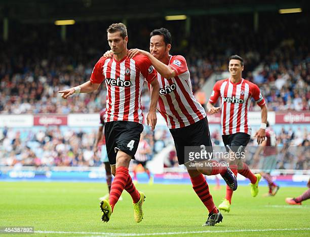 Morgan Schneiderlin of Southampton celebrates scoring his opening goal with Maya Yoshida of Southampton during the Barclays Premier League match...