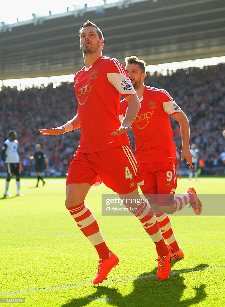 Morgan Schneiderlin of Southampton celebrates scoring the opening goal with Jay Rodriguez of Southampton during the Barclays Premier League match between Southampton and Norwich City at St Mary's Stadium on March 15, 2014 in Southampton, England.