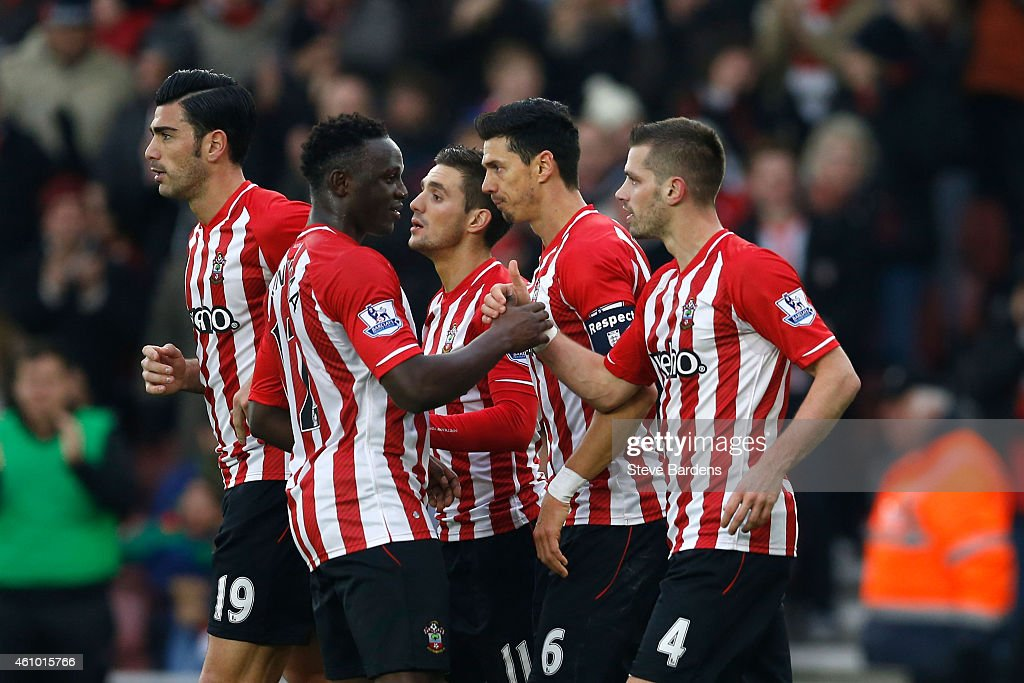 Morgan Schneiderlin #4 (R) of Southampton celebrates with teammates after scoring a goal to level the scores at 1-1 during the FA Cup Third Round match between Southampton and Ipswich Town at St Mary's Stadium on January 4, 2015 in Southampton, England.
