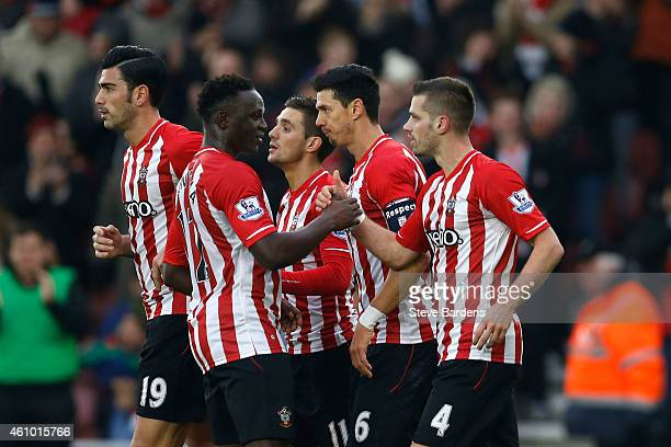 Morgan Schneiderlin of Southampton celebrates with teammates after scoring a goal to level the scores at 1-1 during the FA Cup Third Round match...
