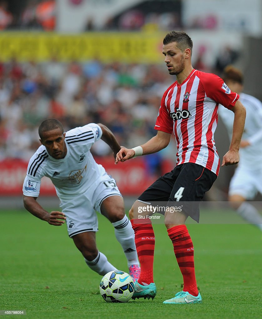 Morgan Schneiderlin (R) of Southampton in action during the Barclays Premier League match between Swansea City and Southampton at Liberty Stadium on September 20, 2014 in Swansea, Wales.