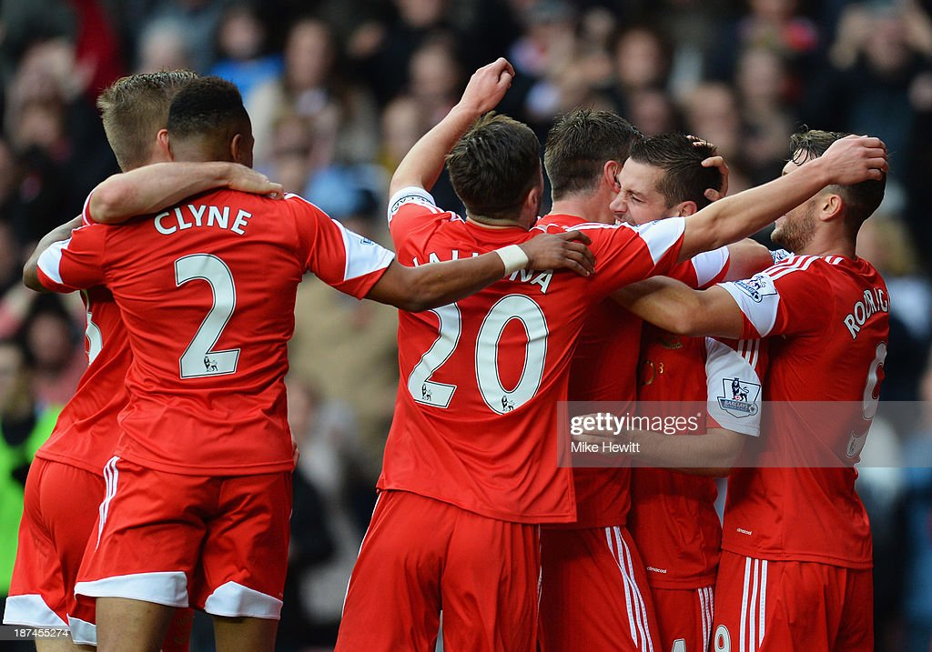 Morgan Schneiderlin of Southampton (2R) is congratulated by team mates as he scores their first goal during the Barclays Premier League match between Southampton and Hull City at St Mary's Stadium on November 9, 2013 in Southampton, England.