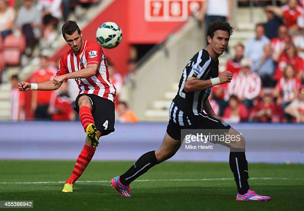 Morgan Schneiderlin of Southampton shoots past Daryl Janmaat of Newcastle United to score their fourth goal during the Barclays Premier League match...