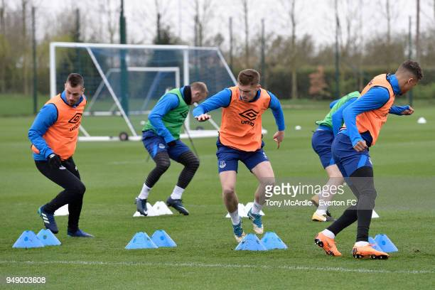 Morgan Schneiderlin Wayne Rooney Jonjoe Kenny and Dominic CalvertLewin during the Everton FC training session at USM Finch Farm on April 17 2018 in...