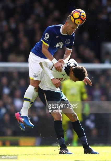 Morgan Schniederlin of Everton beats Dele Alli of Tottenham Hotspur to a header during the Premier League match between Tottenham Hotspur and Everton...