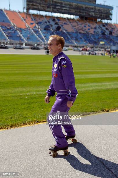 Morgan Shepherd, driver of the Victory in Jesus Chevrolet, roller skates on the grid prior to the start of the NASCAR Nationwide Series Dollar 300 at...